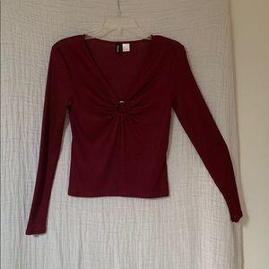 Deep v-neck wine colored blouse